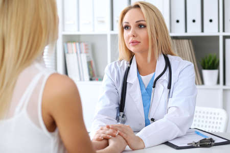 hospital patient: Doctor reassuring her female patient. Medicine, help and health care concept