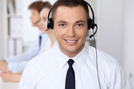 Young business man in headset. Call center