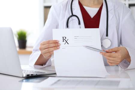 prescription pad: Female medicine doctor hand hold clipboard pad and give prescription to patient closeup. Panacea and life save, prescribe treatment, legal drug store, contraception concept