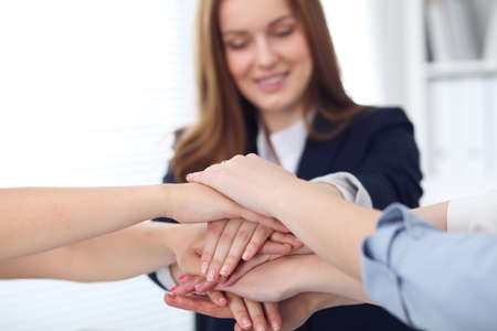 Close Up of unknown business people joining hands. Teamwork, cooperation and success concept of people communication