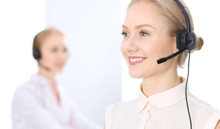 Bright  call center office. Two blonde women in a headset Imagens