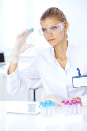 Female scientific researcher or blood test assistant in laboratory. Medicine concept