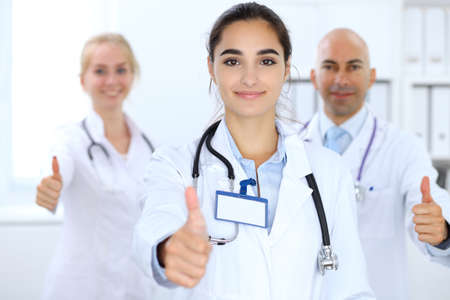 Group of doctors showing OK or approval sign with thumb up. High level and quality medical service, best treatment and patient care concept Stok Fotoğraf