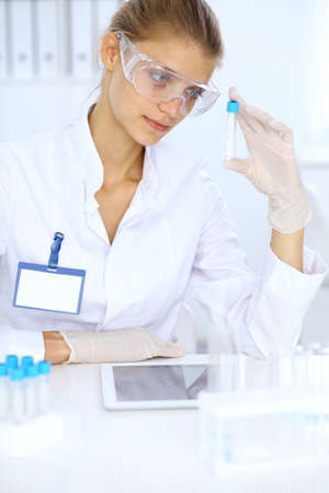 Female scientific researcher or blood test assistant in laboratory. Medicine concept