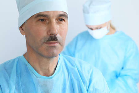 Boss surgeon is examining the operation while medical team are busy of patient. Medicine, healthcare and emergency in hospital Stockfoto