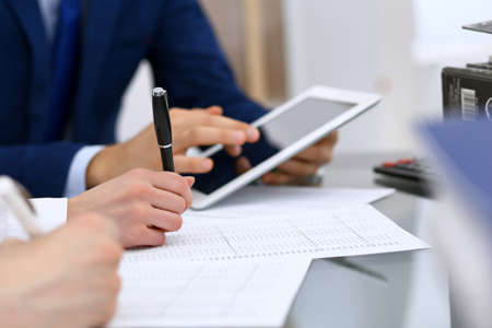 Bookkeepers team or financial inspectors  making report, calculating and checking balance. Tax service financial document. Audit or meeting concept