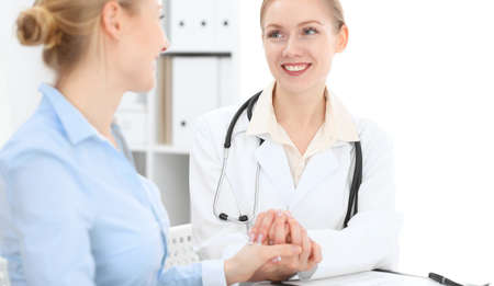 Doctor reassuring her female patient. Medical ethics and trust concept in medicine