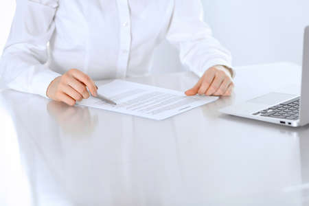 Close-up of female hands with pen over document,  business concept. Lawyer or business woman at work in office Stock fotó