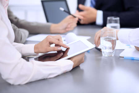 Business people group working together in office, close-up. Meeting and communication concept