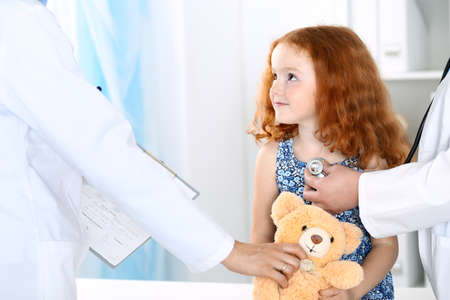 Doctor examining a little girl with stethoscope.Medicine and healthcare concept