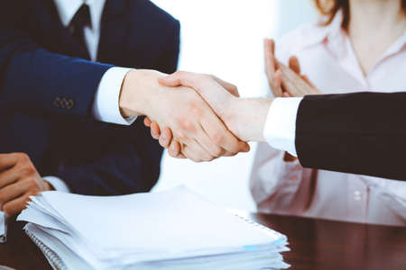 Business people shaking hands finishing up a meeting. Handshake at successful negotiation