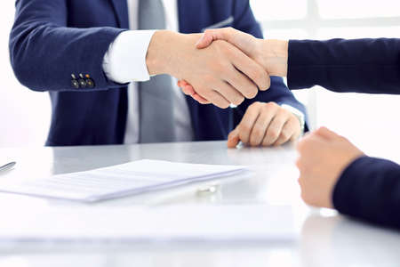 Group of business people or lawyers shaking hands finishing up a meeting , close-up. Success at negotiation and handshake concepts Imagens - 121615851
