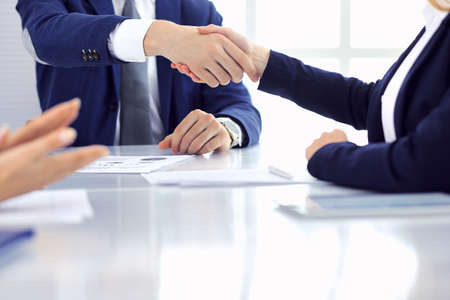 Group of business people or lawyers shaking hands finishing up a meeting , close-up. Success at negotiation and handshake concepts Imagens - 121616236