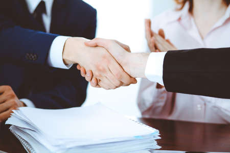 Business people shaking hands finishing up a meeting. Handshake at successful negotiation Imagens - 121617169