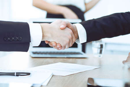 Business people shaking hands at meeting or negotiation in the office. Handshake concept. Partners are satisfied because signing contract