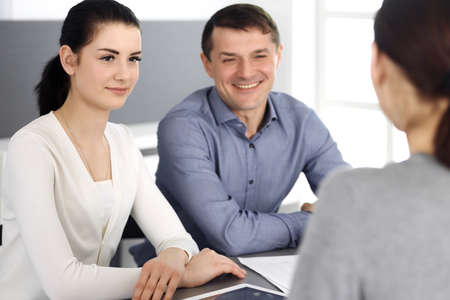 Group of business people discussing questions at meeting in modern office. Headshot at negotiation or workplace. Teamwork, partnership and business concept Stockfoto - 121111496