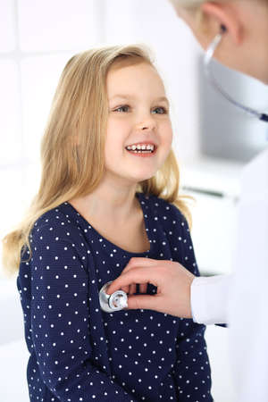 Doctor examining a child patient by stethoscope. Cute baby girl at physician appointment. Medicine concept Stockfoto - 121111690