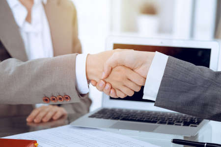 Business handshake after contract signing. Two women shaking hands after meeting or negotiation
