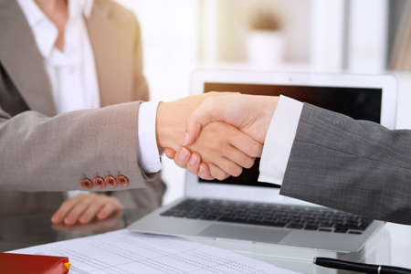 Business handshake after contract signing. Two women shaking hands after meeting or negotiation Stock Photo