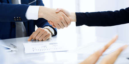 Business people shaking hands finishing up a meeting , close-up. Success at negotiation and handshake concepts. Group of lawyers at work 写真素材