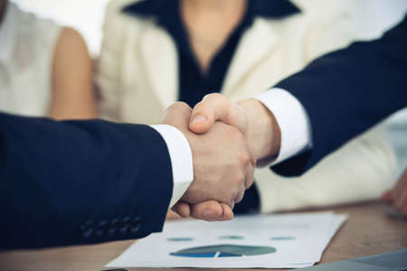 Business people shaking hands at meeting or negotiation in the office. Handshake concept. Partners are satisfied because signing contract.