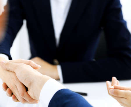Business people shaking hands finishing up a meeting , close-up. Success at negotiation and handshake concepts. Group of lawyers at work Reklamní fotografie