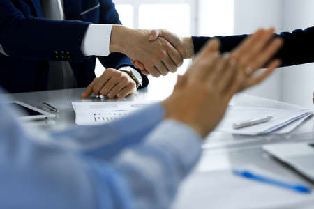 Business people shaking hands finishing up a meeting , close-up. Success at negotiation and handshake concepts. Group of lawyers at work Stockfoto