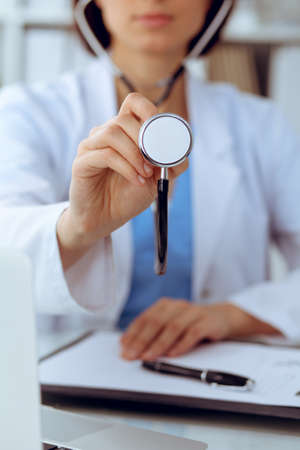 Doctor with a stethoscope in the hands, close up. Physician ready to examine and help patient. Medicine, healthcare and help concept Stockfoto