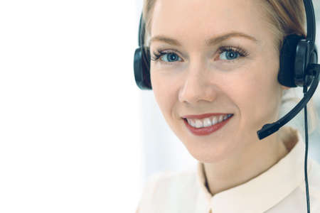Bright and sunny call center. Group of blonde women in headset at work. Office and business concept Imagens