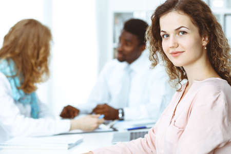 Business woman at meeting in office, colored in white. Multi ethnic business people group