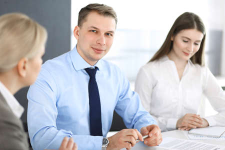 Group of business people discussing questions at meeting in modern office. Headshot of businessman at negotiation. Teamwork, partnership and business concept Reklamní fotografie