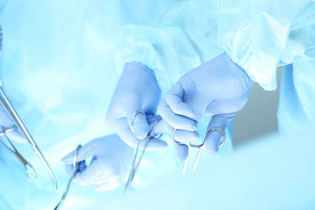 A group of surgeons is operating at the hospital, close-up of hands. Health care concept
