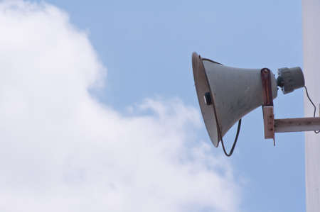 Old loudspeaker against cloudy blue sky  Stock Photo - 13448974