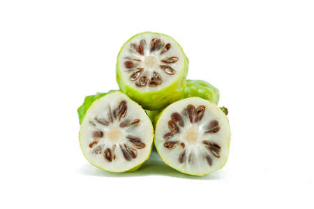 Noni fruits on white isolated background  Stock Photo