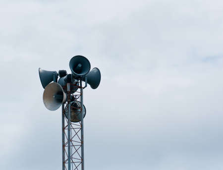 Old loudspeaker against  photo