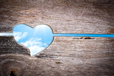 Wooden door , heart shape and blue sky Stock Photo