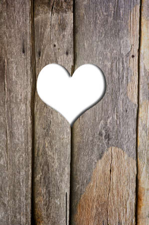 look through window: heart in a wooden wall background  Stock Photo