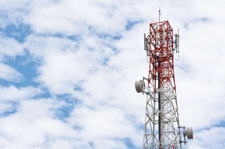 telco: Red and white tower of communications with with a lot of different antennas