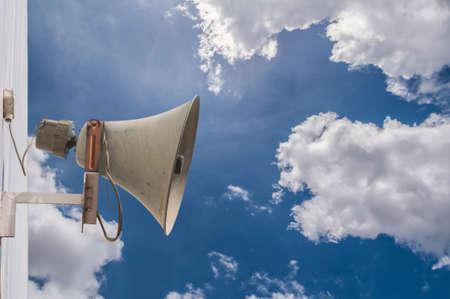 amplification: Old loudspeaker against cloudy blue sky