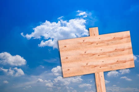 unbalanced: Wooden sign on blue sky Stock Photo