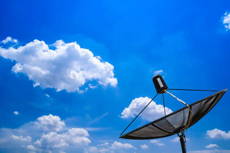 Satellite dish and blue sky  Stock Photo