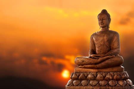 Boeddha en zonsondergang Stockfoto - 27566659