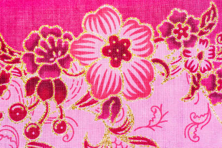 Pink flower batik sarong pattern background in Thailand