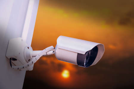 Security cameras for the safety and sunset background