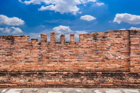 Old brick wall and blue sky Stock Photo