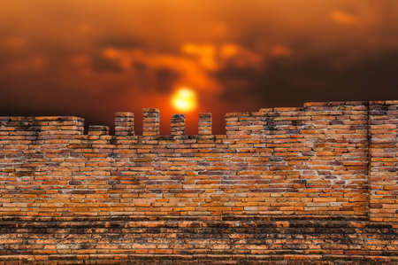 Old brick Wall and sunset background