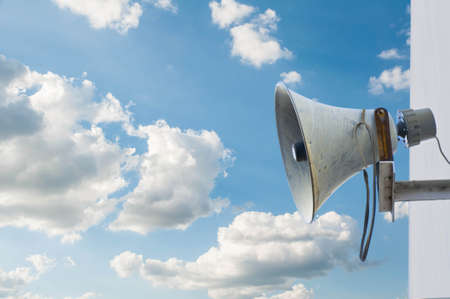 Old loudspeaker and blue sky Stock Photo
