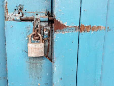 blue door: Old padlock and blue door