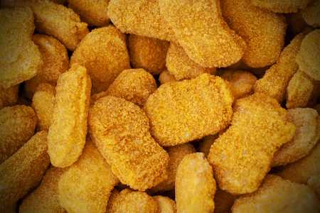 Frozen nuggets spread out evenly as a background.
