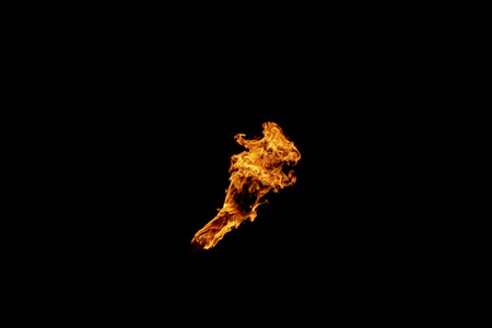 Fire, flame on a black background. Fire for advertising. An unusual game of bright red and yellow colors.